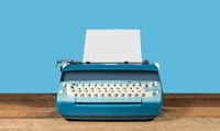 Old electric typewriter on wood table background