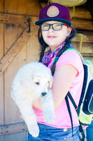 Young hikker girl outdoors holding a big puppy
