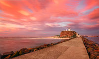Red sunrise at Nobby's Lighthouse Australia