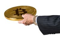 Businessman hand offering Bitcoin to trade