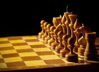 Chessboard with figures on dark background