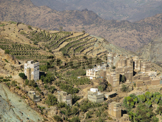View to Manakha fortress and old city and terrace farming, Yemen
