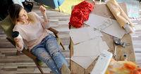 Female tailor having rest in workshop