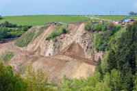 opencast mining quarry with machinery
