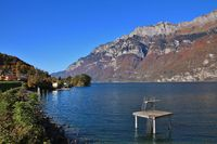 Lake Walensee and mountains of the Churfirsten range in autumn. View from Mols, Switzerland.