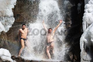 Swimming in winter waterfall