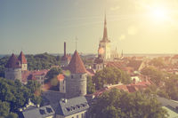 aerial view on observation deck of Old city's roofs and St. Nicholas' Church (Niguliste) . Tallinn. Estonia. toning