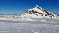 Mount Oldenhorn and ski slope on the Diablerets glacier, Switzerland. Clear blue winter day.