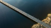 Kiev, Ukraine view from above on the North Bridge with passing cars through the Dnieper River, photo from the drone