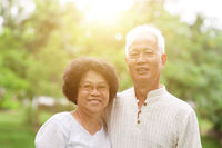 Happy old Asian couple smiling.