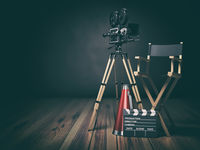Video, movie, cinema concept. Retro camera, clapperboard and director chair. 3d