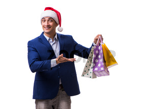 Young man with bags after christmas shopping on white background