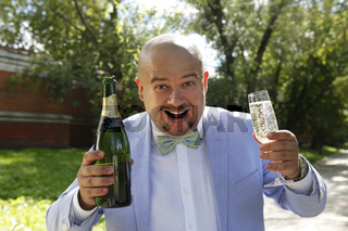 Happy groom with a bottle of champagne