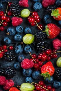 Mixed fresh ripe berries background