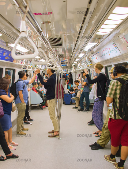 People inside subway train. Singapore