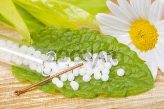 Naturmedizin un Alternativmedizin mit Globuli und Akupunktur