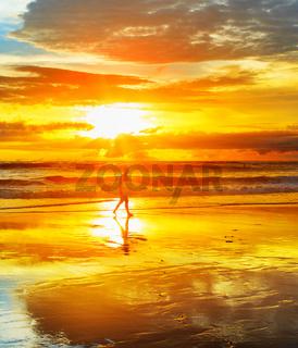 Surfer on a beach. Bali island