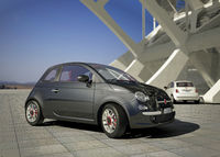 Fiat 500 city car, outside of a modern industrial building environment.
