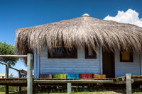 Typical brightly colored hous on the picturesque beach in Punta del Diablo, popular tourist place in Uruguay