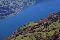 Lake Walensee and colorful forest. Walenstadtberg. View from Chaeserrugg. Autumn scene in Switzerland.