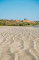 beach sand closeup with blurred landscape background