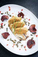 gourmet fish fillet with chickpea curry puree meal