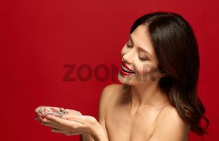 beautiful woman with red lipstick holding diamond