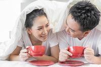 Couples having breakfast on bed