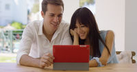 Smiling couple using a tablet computer together