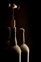 Old wine bottles and corkscrew