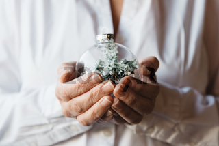 Close-up of woman hands holding Christmas bauble