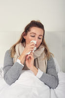 Sick woman with seasonal cold and flu