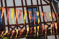 Facade of a typical brittany house with wooden beams and streamers at the forefront