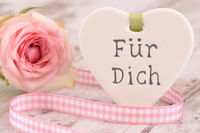 rose flower and heart with inscripton in german language: for you