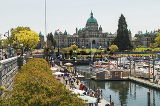People in Inner Harbour in Victoria BC in Canada