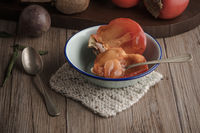 Persimmon fruit on rustic table