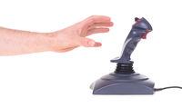 Hand holding gaming joystick