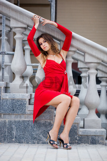 Beautiful woman near the stairs