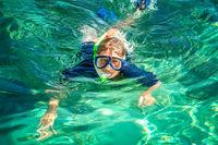 Woman snorkeling in clear ocean waters