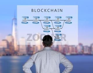 Senior technologist looking at blockchain illustration
