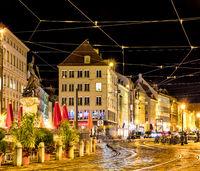 Illuminated historic house facades in Augsburg at night
