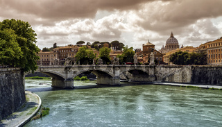 Tiber river, Ponte Sant'Angelo and St. Peter's cathedral, Roma, Italy