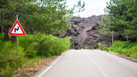 hardened lava flow broken road on slope of Etna
