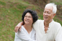 Old Asian couple outdoor.