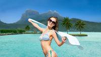 woman in bikini and sunglasses on bora bora beach