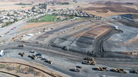 Aerial View Of Tractors On A Housing Development Construction Site.