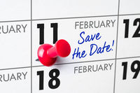 Wall calendar with a red pin - February 11