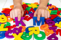 Child learning using magnetic numbers and letters
