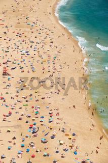 Bird's-eye view on Nazare sandy beach riviera on the coast of Atlantic ocean