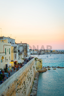 OTRANTO, ITALY - AUGUST 23, 2017 - panoramic view from the old town at sunset during turistic season